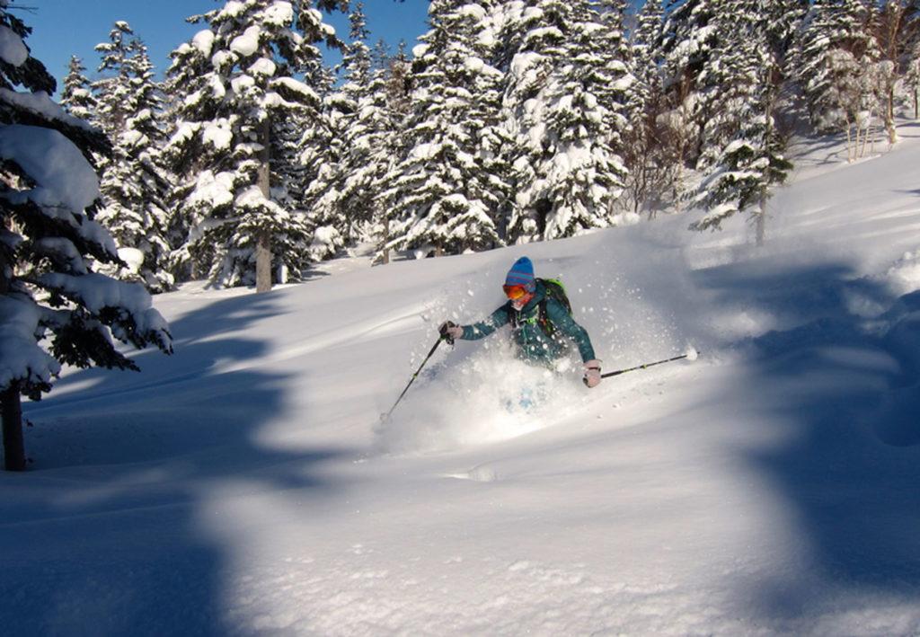 Skiing deep powder in Japan during our ski trip to Hokkaido