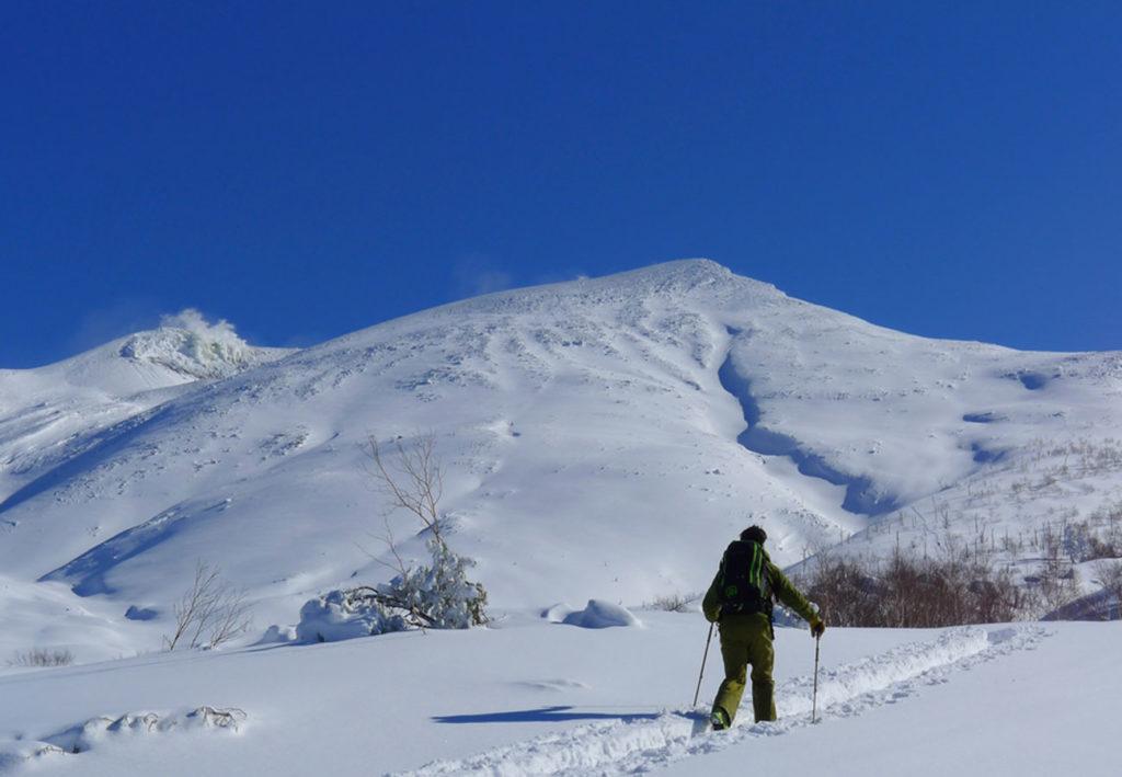 Skitouring up to Tokachi volcano in Hokkaido in Japan