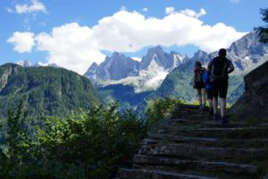 hiking the panoramic trail opposite the famous Piz badile in the Swiss alps