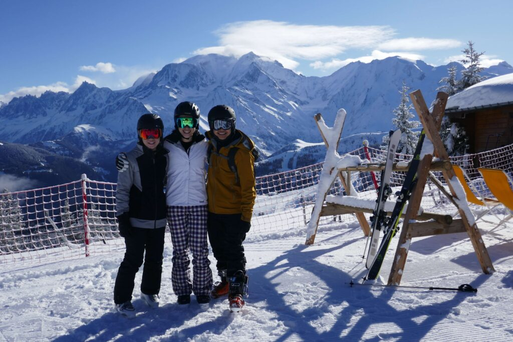 Happy skiers in Megeve with Mont Blanc in the back
